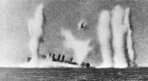 Scene of a sinking ship after being attacked by the Japanese in World War 2