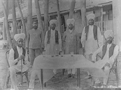 Sikh police in front of government quarters